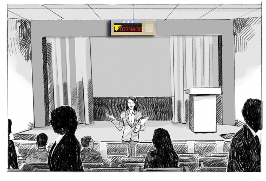 A lecture hall evacuates due to the multi-color Tornado warning message on the Large IP Display device.